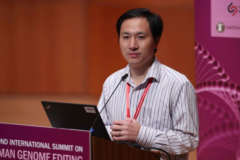 He Jiankui speaking at a conference