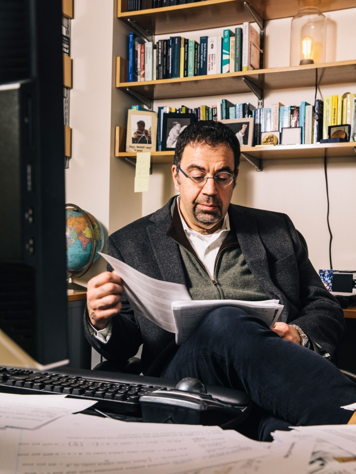 Daron Acemoglu at his desk