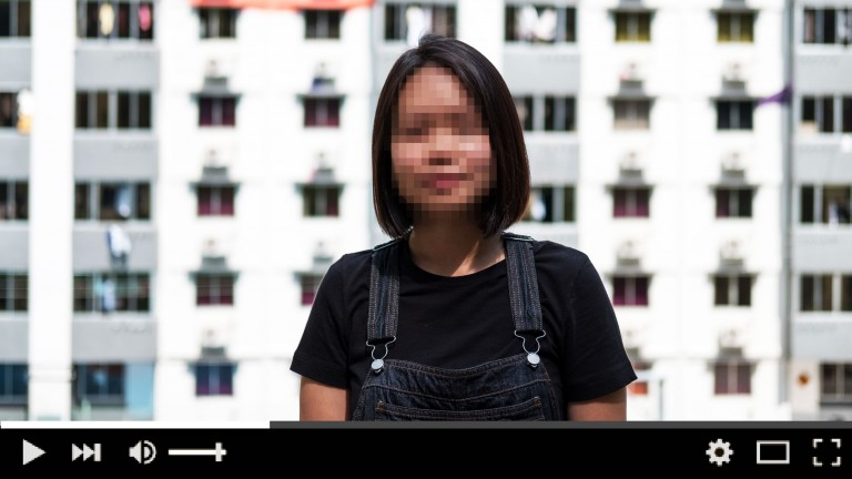 Woman in video with face blurred
