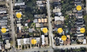 A Google Maps photo of rooftops with solar panels highlighted