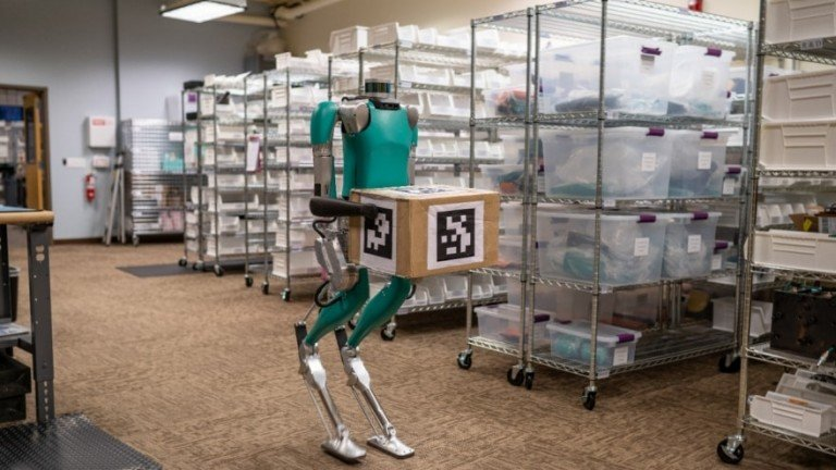 A two-legged robot holding a package