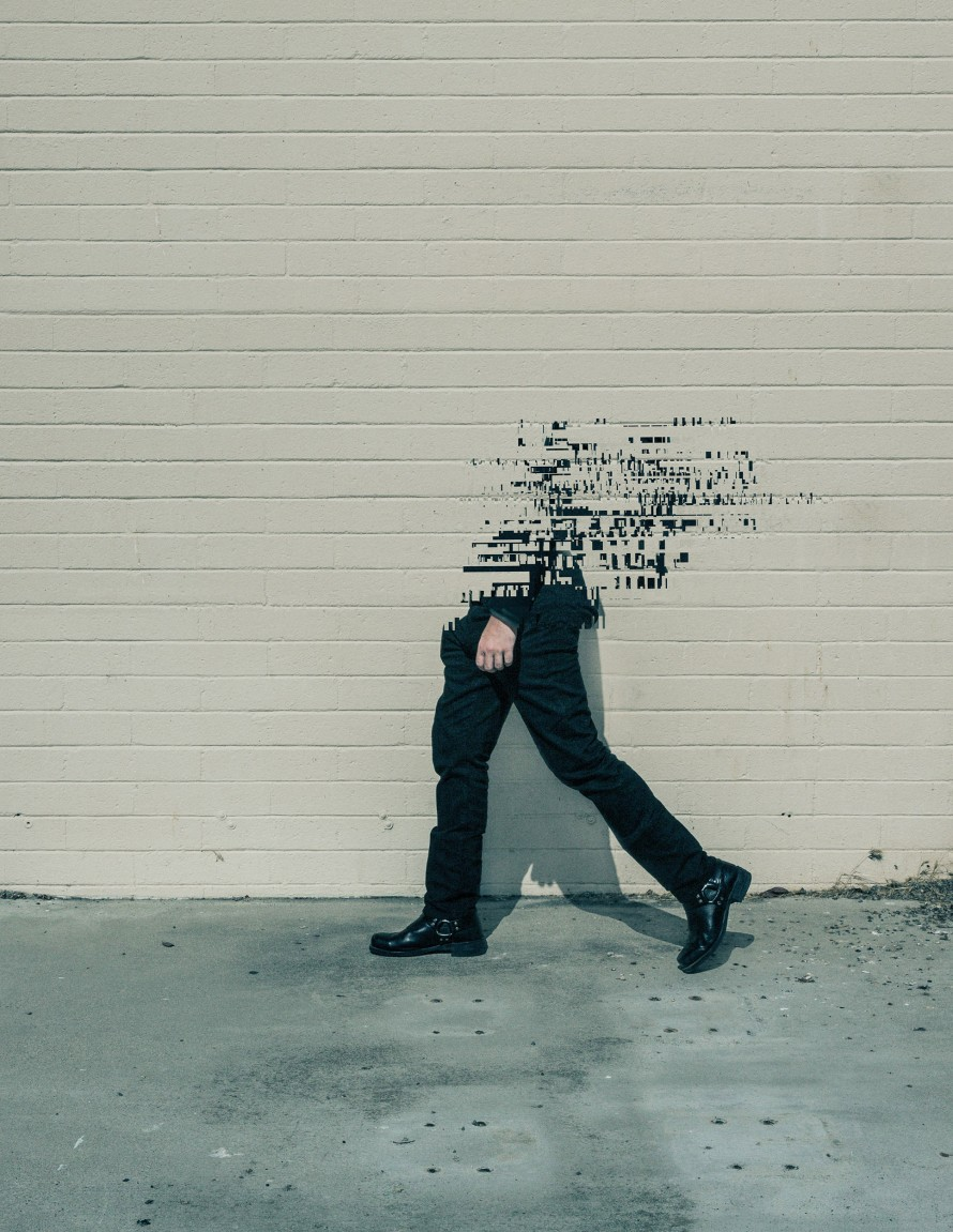 Illustration of a person walking on a sidewalk and disintegrating into the air.