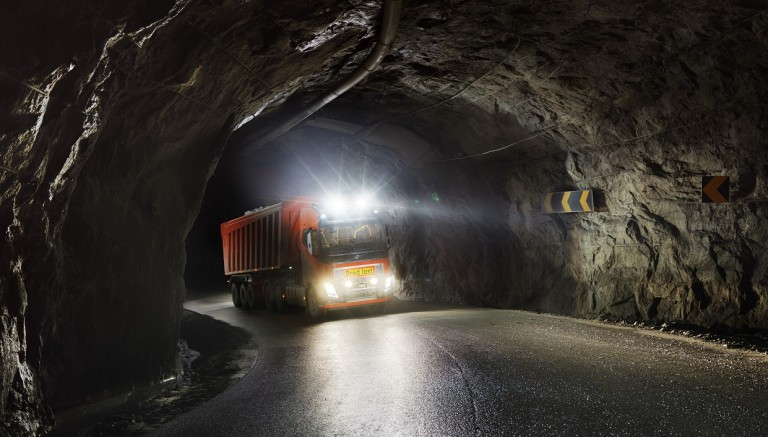 A driverless truck travelling through a tunnel