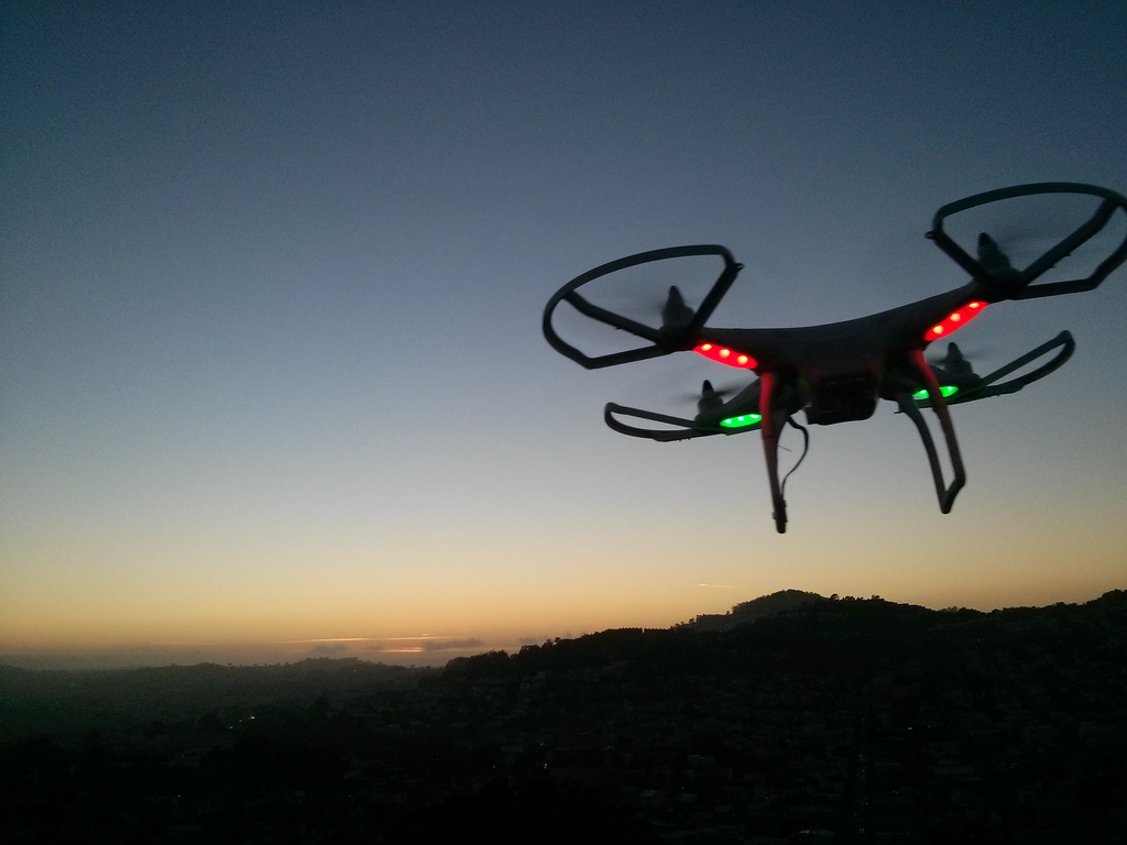 A drone flying at dusk