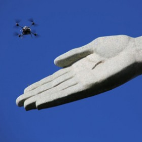 drone flies around hand in Rio's Christ the Redeemer stature to capture photos