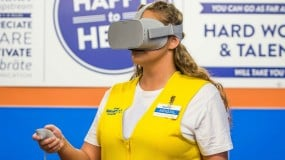 Image of a Walmart worker using a VR headset.