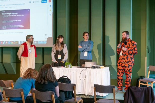 Photo of four speakers at Devcon