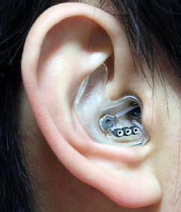 Picking up signals: A custom earpiece with three electrodes records from within the hearing canal.