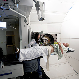 man going into MRI with MD by his side