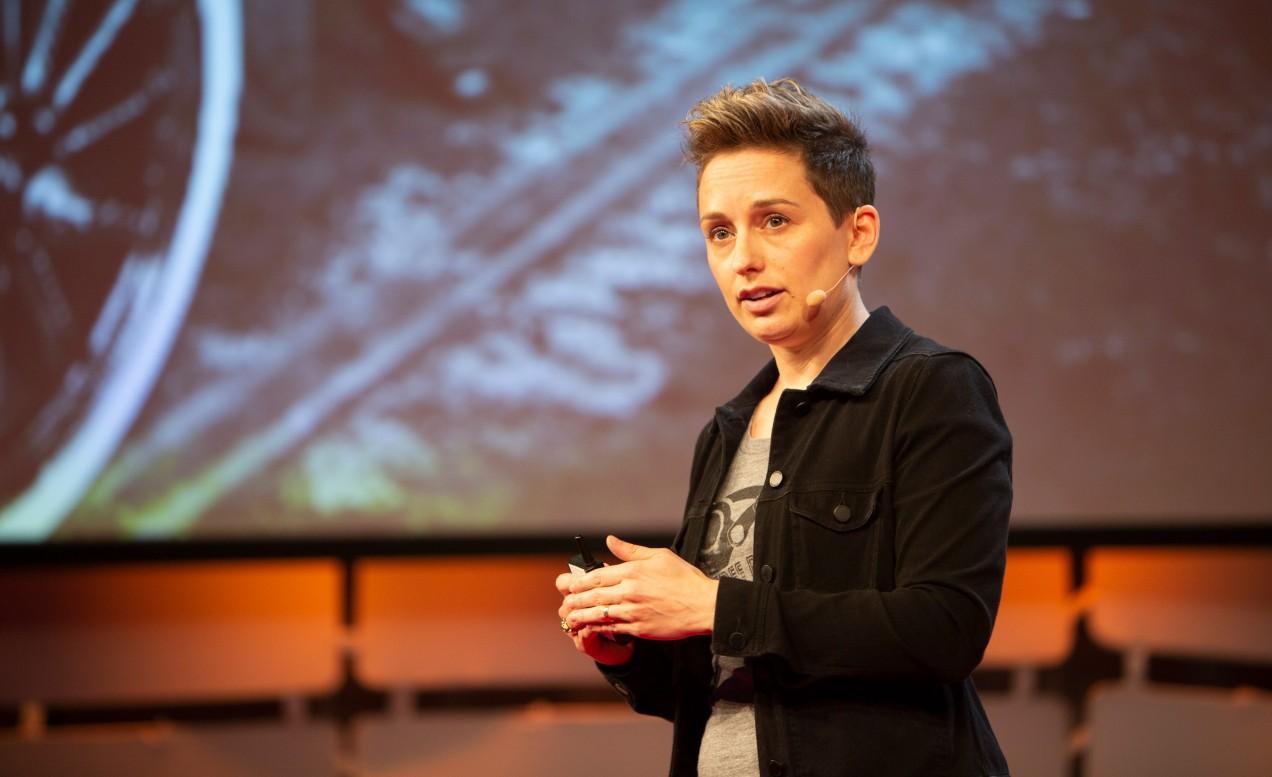Photo of Clara Vu speaking at EmTech 2018