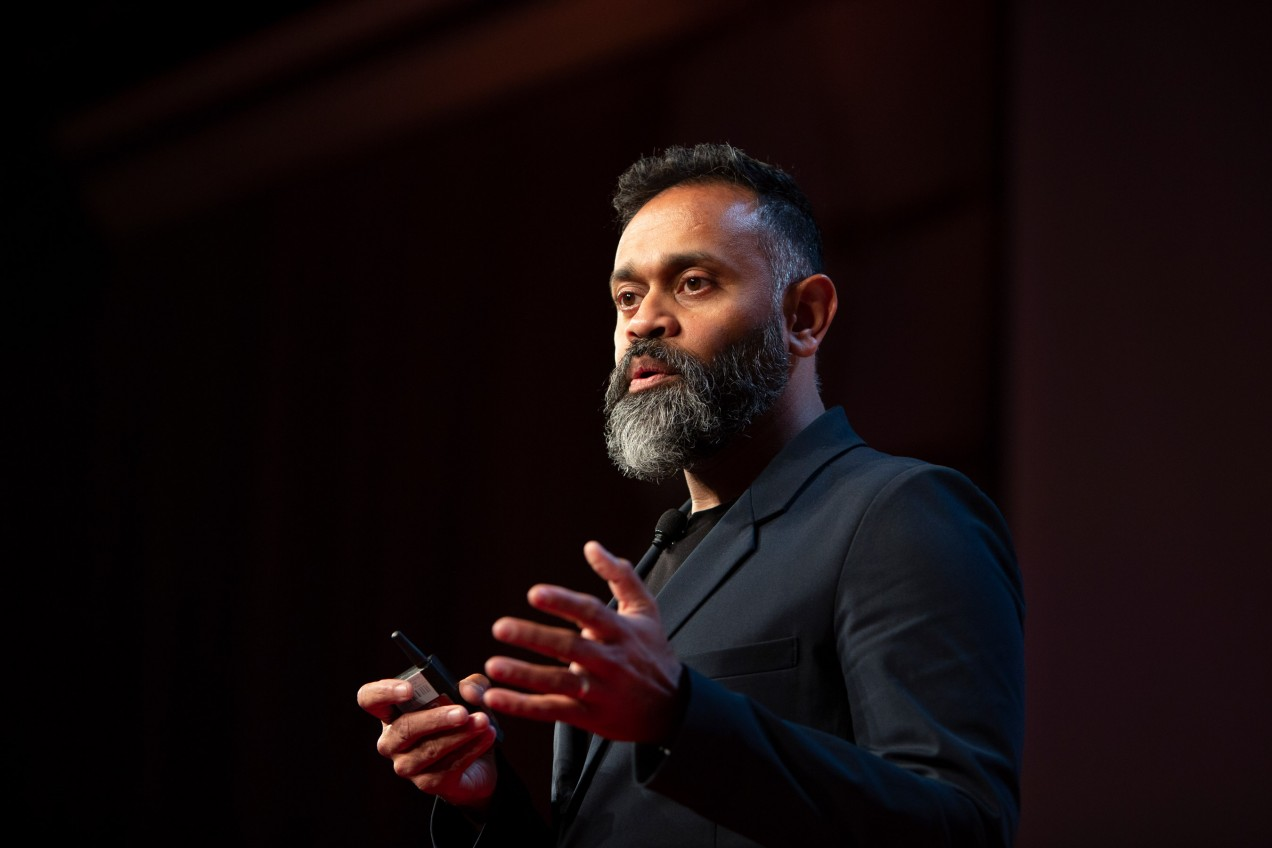 Photo of Ganesh Bell speaking at EmTech 2018