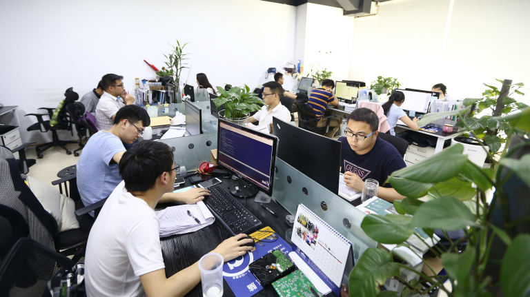 Chinese engineers hard at work in an office