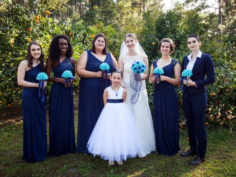 Photo of bridal party holding 3-d printed bouquets.