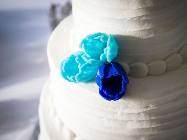 Photo of cake with 3-d printed flowers