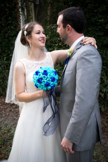 Erin standing with her husband holding her bouquet