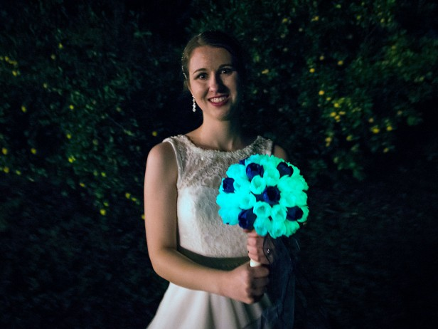 Erin holding glow-in-the-dark 3-d printed flower bouquet