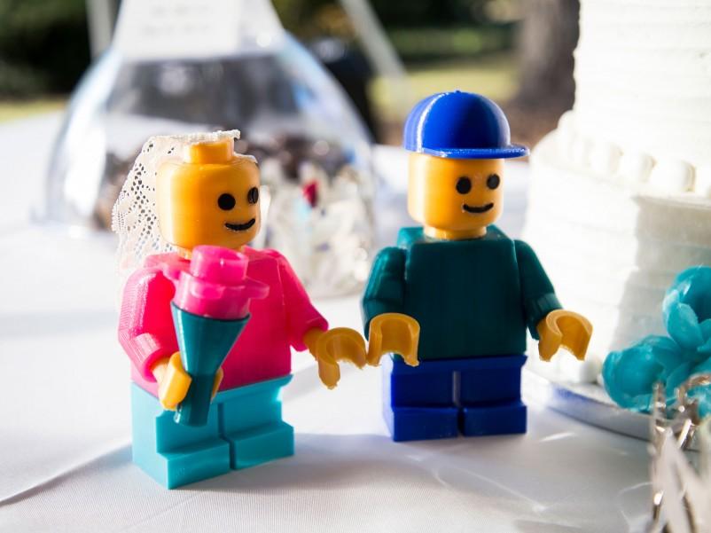 3-d printed bride and groom figurines.
