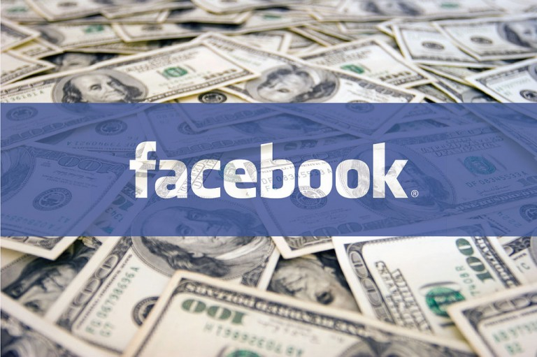 Facebook's logo with dollar bills in the background