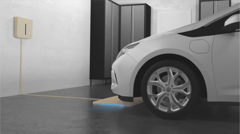 Rendering of cars on charging platforms in a home garage.