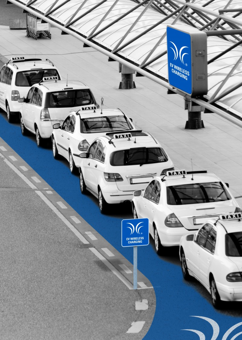 Rendering of taxi vehicles on an indoor, road-like charging platform.