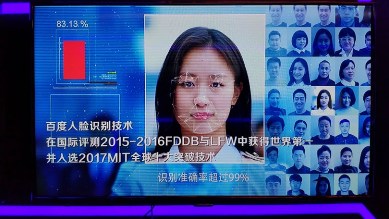 A woman's face being scanned by face recognition software