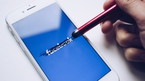Facebook's logo on a smartphone, rubbed out