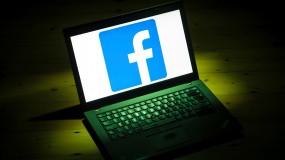 Facebook's logo taking up an entire open laptop screen