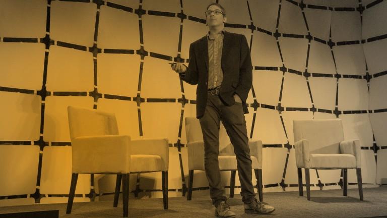 Man on stage at EmTech Digital