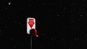 """A conceptual illustration showing a """"Please take a number"""" dispenser in space"""