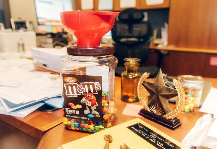 desk in Dr Gahl's office with M&M candies