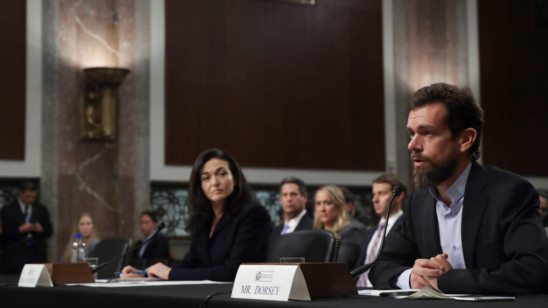 Image of Facebook COO Sheryl Sandberg and Twitter CEO Jack Dorsey testifying in front of Congress.