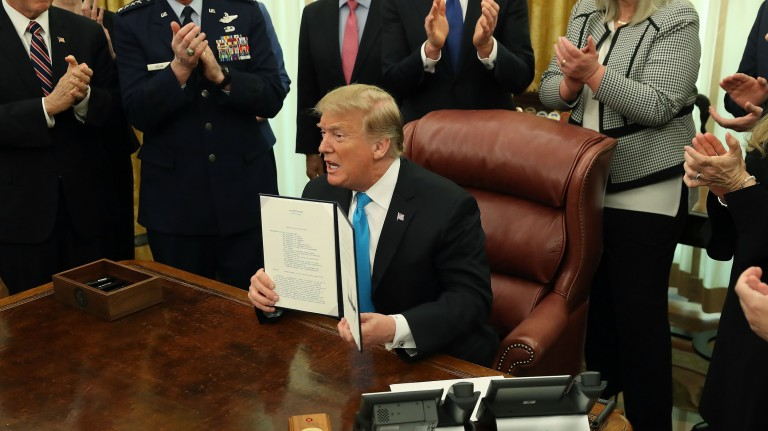 Image of President Donald Trump signing the new space directive.