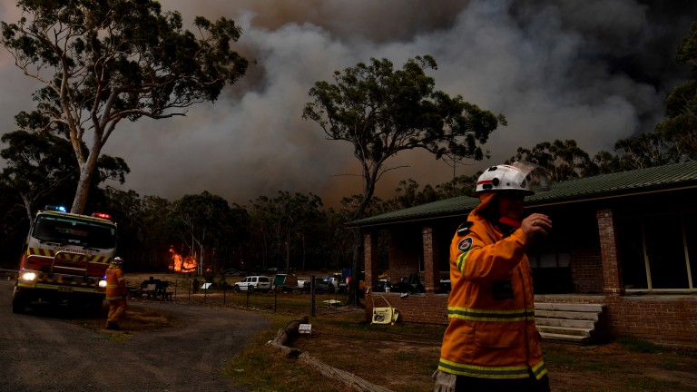 Rural Fire Service firefighters battle blazes near the town of Sussex Inlet in late December.