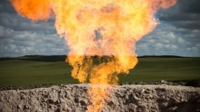Flaring methane at a fuel extraction site.