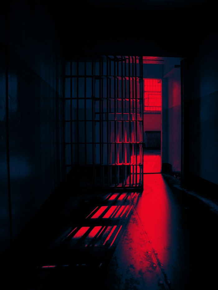 A prison cell with an open door