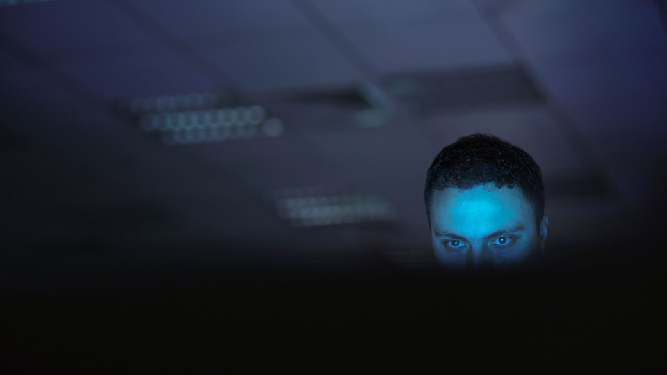 man with blue light on his face searching internet reddit manosphere incel pick up artist mens rights gab toxic