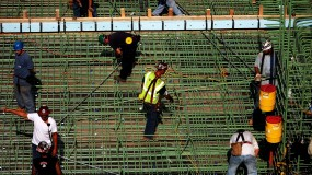 An image of construction workers