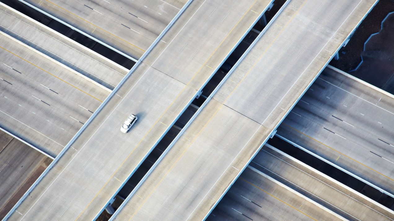 photograph of a single car on an highway