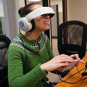 person wearing Glyph headphones