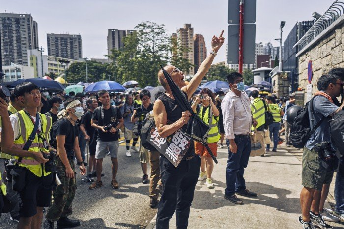 Protestors outside of the Yuen Long Police Station, expressing their distrust and displeasure with how the police responded to the triad attacks at the Yuen Long West Rail Train Station. Yuen Long, New Territories, Hong Kong. July 27th, 2019.