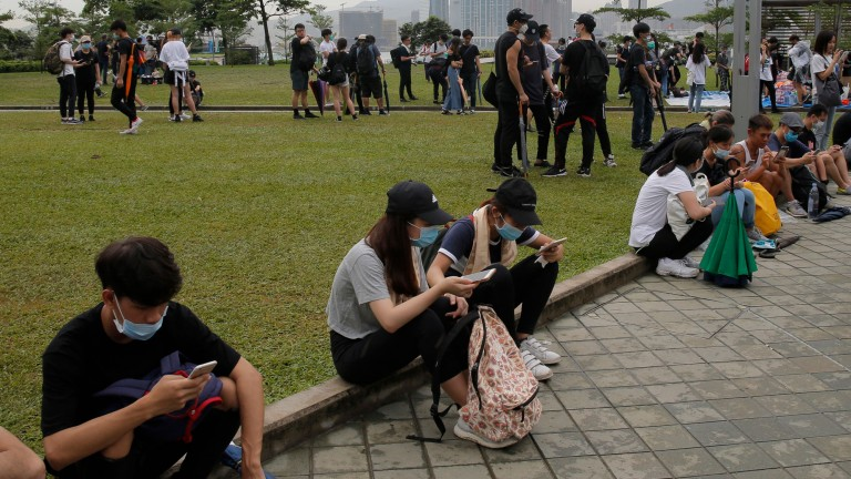 Protesters in Hong Kong on their smartphones