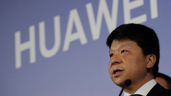 Huawei's rotating chairman Guo Ping addresses reporters in Shenzhen, China