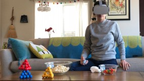 Image of woman in living room wearing VR headset
