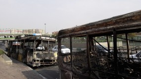 Scorched public buses that remained on the street in Tehran, Iran, after protests that followed authorities' decision to raise gasoline prices