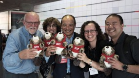 Photo of volunteers holding beaver stuffed animals