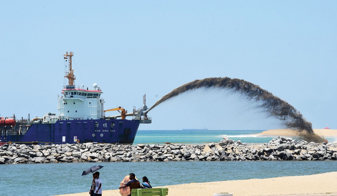 Photograph of the Wan Qing Sha, a trailing suction hopper dredger, helps build a new city off the coast of Colombo as part of a massive Chinese infrastructure project, the largest foreign investment in Sri Lanka's history.
