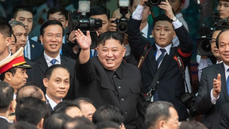 North Korean leader Kim Jong-un waves to photographers.