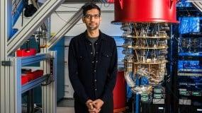 Photograph of Sundar Pichai standing next to a quantum computer at Google