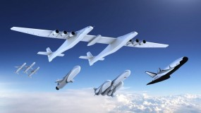 Image of Stratolaunch plane and newly announced rockets flying in the sky.