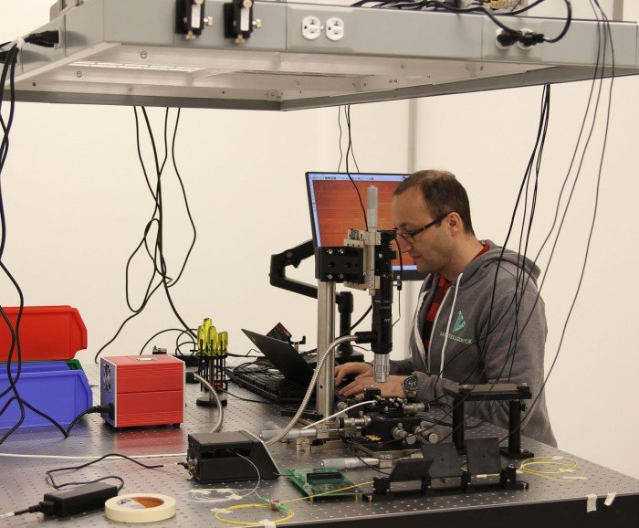 Photo of man in Lightelligence chip lab.